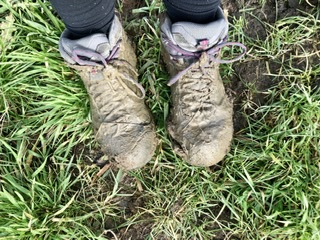 Muddy walking boots on adventures in our van blog